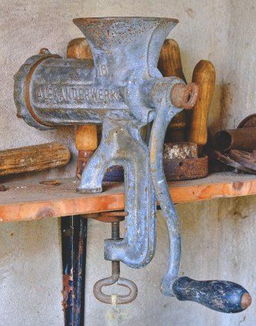 A Manual Meat Grinder Works via Crank Rotation